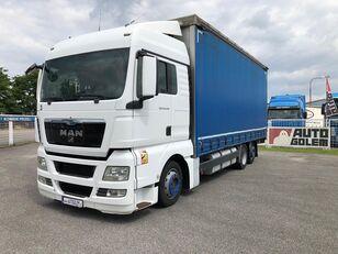 truk jungkit MAN TGX 24.440 flatbed